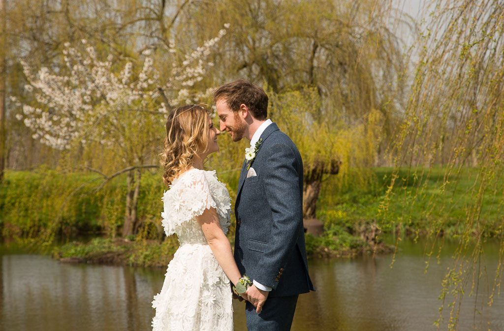Romantic Wedding Couple by Lake - Outdoor Wedding