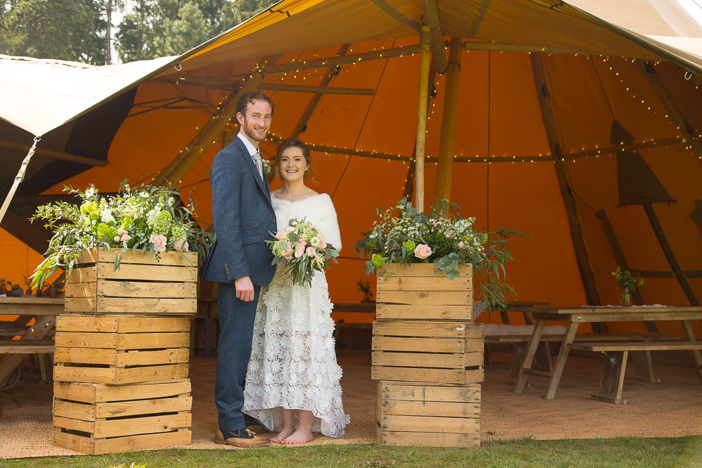 Wedding Couple With Crates of Flowers