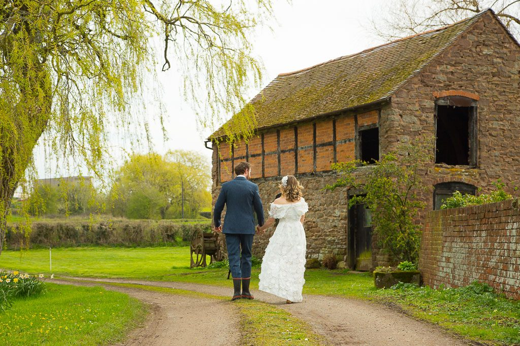Wedding Couple by Farm Buildings