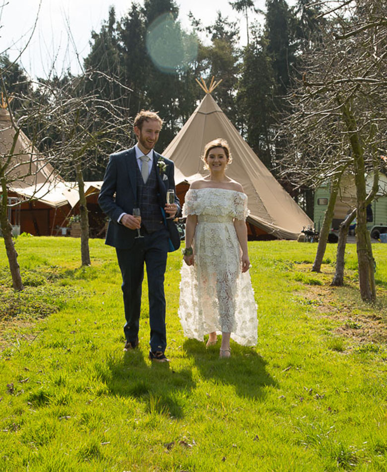 Wedding Couple with Tipi in The Background