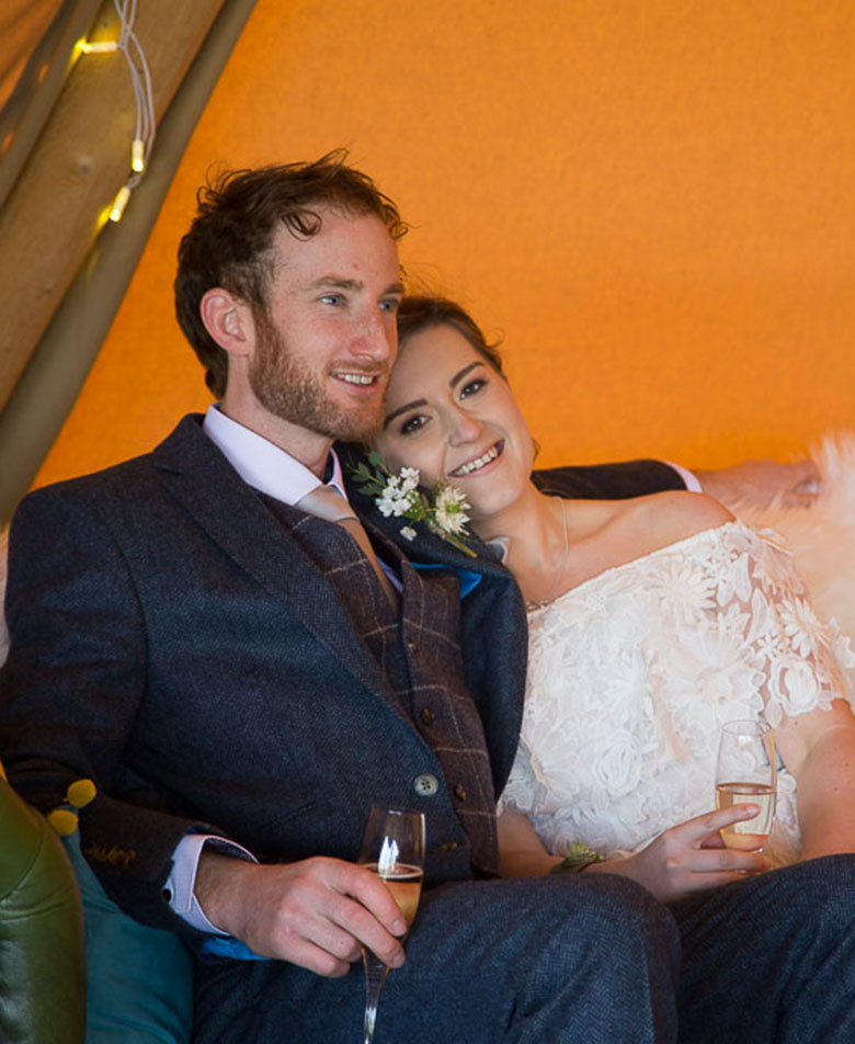 Chilled Out Wedding Couple Tipi Wedding