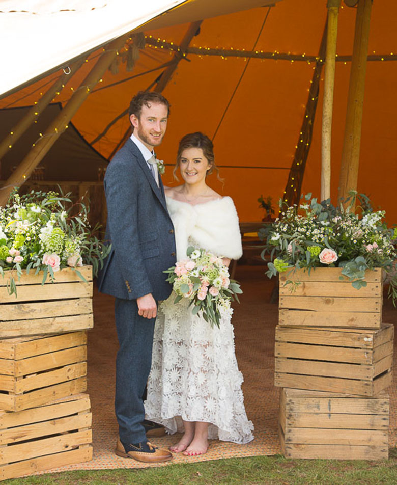 Tipi Wedding with Floral Arrangements